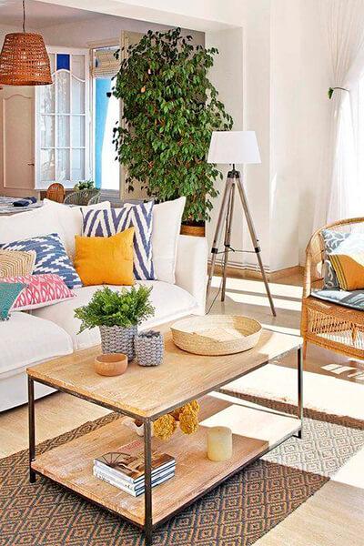 cojines y plaids de algodon en el sofá